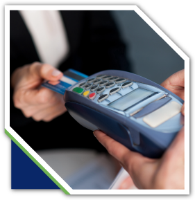 Person inserting debit card into card reader